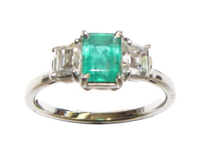 Platinum 3 stone diamond and emerald ring