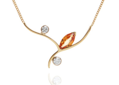 18ct yellow and white gold diamond and mandarin garnet necklace