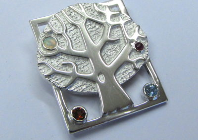 Silver tree brooch with birthstones