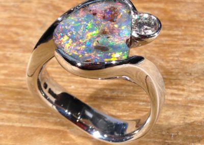 Platinum boulder opal and diamond ring