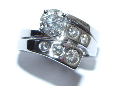 Fitted wedding ring with gypsy set diamonds