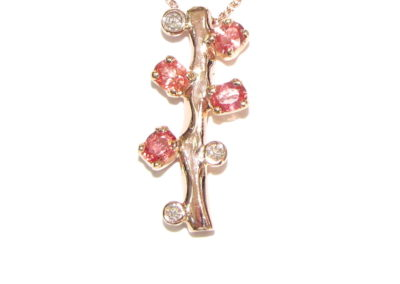 9ct rose gold diamond and orange sapphire pendant