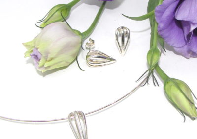 silver pendant and matching earrings