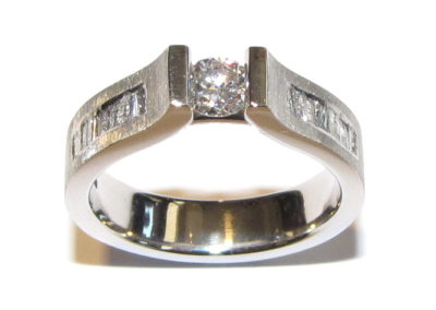engagement ring with channel set shoulders