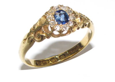 18ct yellow gold 11 stone diamond and sapphire ring