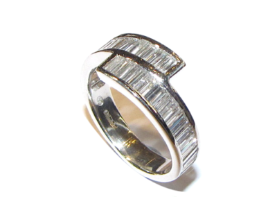Platinum baguette cut diamond crossover ring